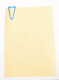 Parchment paper with blue paper clip. Stock Photography