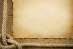 Parchment paper and ship ropes royalty free stock photo