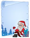 Parchment with Santa Claus and gift Stock Photo