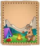 Parchment with scout by campfire Stock Photo
