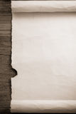 Parchment scroll on wood Royalty Free Stock Images
