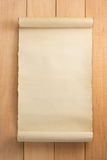 Parchment scroll on wood Royalty Free Stock Photos