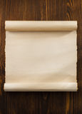 Parchment scroll on wood. En background stock photo