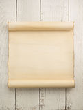 Parchment scroll on wood Royalty Free Stock Image