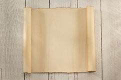 Parchment scroll on wood Stock Images