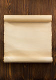 Parchment scroll on wood Stock Photos