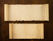 Parchment scroll on wood Royalty Free Stock Photography