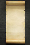 Parchment scroll on wood. En background Royalty Free Stock Photography