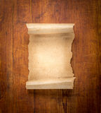 Parchment scroll on wooden background Stock Photos