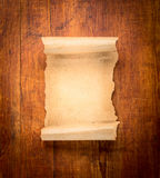 Parchment scroll on wooden background Royalty Free Stock Photos