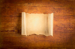Parchment scroll on wooden background royalty free stock image