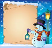 Parchment with snowman holding lantern Royalty Free Stock Photos