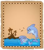 Parchment with two dolphins Stock Image
