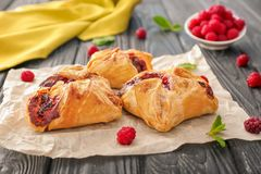 Free Parchment With Delicious Puff Pastries Royalty Free Stock Photo - 106300145