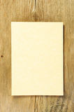 Parchment on wood. Piece of parchment paper on old weathered wood stock images