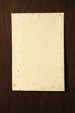 Parchment on wooden board Stock Photos
