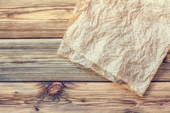 Parchment on wooden boards Stock Photo