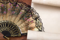 Parchment for your text with a female fan Royalty Free Stock Photo