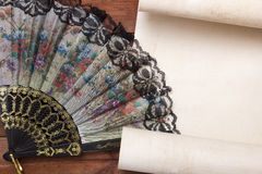 Parchment for your text with a female fan Royalty Free Stock Image
