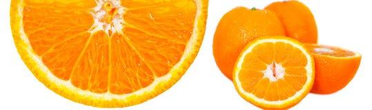 Parcialmente uma laranja sobre o branco imagens de stock
