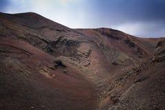 Parco nazionale di Timanfaya, Lanzarote, isole Canarie, zona del turista del primo piano delle colline Immagine Stock Libera da Diritti