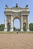Parco Sempione and the Arch of Peace. MILAN, ITALY- JUNE 11, 2015: Some tourits at the Parco Sempione, the Arch of Peace (Porta Sempione) and the Scorfesco Royalty Free Stock Photography
