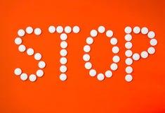 Pare con las píldoras Imagen de archivo libre de regalías