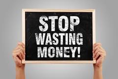 Pare de desperdiçar o dinheiro Imagens de Stock Royalty Free