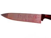 Pare el concepto del crimen del cuchillo en el fondo blanco Fotos de archivo