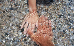 A pare of hands covered with water Stock Images