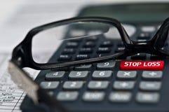 Pare la calculadora de la pérdida Foto de archivo libre de regalías
