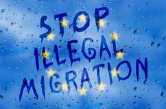 Pare la migración ilegal Foto de archivo