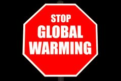 Pare la muestra del calentamiento del planeta aislada en negro Imagenes de archivo