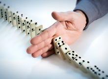 Pare o efeito de dominó - a mão impede imagens de stock