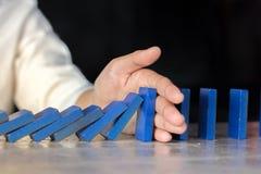 Pare o efeito do risco do dominó imagem de stock royalty free