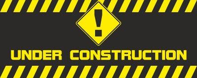 Pare o sinal de tráfego sob a construção Imagens de Stock Royalty Free