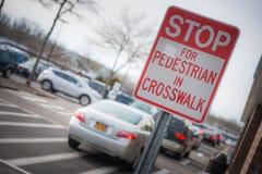 Pare o sinal na faixa de travessia com carros atrás Imagem de Stock Royalty Free