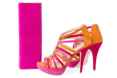 Pare of pink and orange shoes and a matching bag Stock Photo