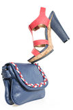 Pare of trendy navy blue and red shoes, with matching bag,  isol Royalty Free Stock Photo