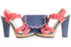 Pare of trendy navy blue and red shoes, with matching bag Stock Images