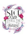 Pare y huela las rosas Fotografía de archivo libre de regalías