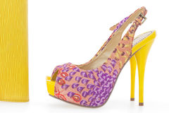 Pare of yellow women stiletto shoes with bag Royalty Free Stock Photo