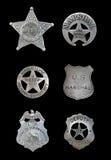 Parecchi distintivi dello sceriffo e della polizia Fotografie Stock