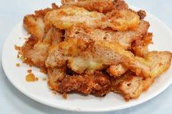 Parecer vegetal de la proteína el cerdo frito en plato Imagen de archivo