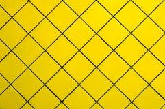 Pared amarilla del azulejo Fotografía de archivo libre de regalías