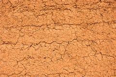 Pared anaranjada de la textura del fango Imagen de archivo