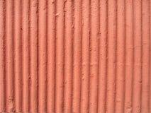 Pared anaranjada texturizada del yeso Foto de archivo libre de regalías