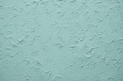 Pared azul con el estuco grabado en relieve Foto de archivo