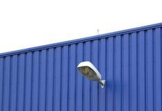 Pared azul con la lámpara Imagenes de archivo