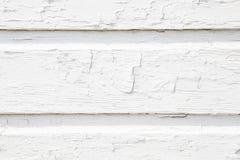 Pared blanca de madera del listón con la pintura que se agrieta Fotos de archivo